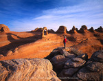 ARCHES NATIONAL PARK, UTAH. USA. Delicate Arch & hiker at sunrise.
