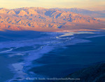 Death Valley National Park, California. USA. View from Dante's View at dawn. Water in channel of Salt Creek on playa after wet spring. Panamint Range in distance.