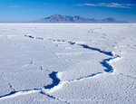 Utah. USA. Pressure ridges in salt crust. Bonneville Salt Flats. Silver Island Mountains in distance. Great Salt Lake Desert. Great Basin.