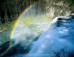 Idaho. USA. Rainbow in spray above Upper Mesa Falls on Henrys Fork of Snake River.