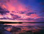 Yellowstone National Park, Wyoming. USA. Cumulus & cirrus clouds reflected in Yellowstone Lake at sunset.