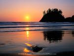 Trinidad State Beach, California. USA. Sea stack & setting sun. Pacific Ocean.