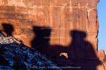 Arches National Park, Utah. USA. Shadow of The Three Gossips on sandstone wall with small arch. Park Avenue.
