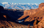 Utah. The Book Cliffs and East Tavaputs Plateau rise above Colorado River Canyon and frozen-over Colorado River. View from Richardson Amphitheater.