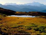 Denali State Park, Alaska. USA. Denali (Mount McKinley) & Mount Foraker rise above tarn on Kesugi Ridge. Alaska Range.