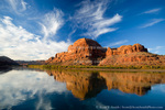 UTAH. USA. Cliffs & cirrus clouds reflected in Colorado River at Gold Bar. Colorado Plateau.