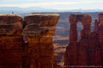 CANYONLANDS NATIONAL PARK, UTAH. USA. Hiker on sandstone above Monument Canyon. Along White Rim. Colorado Plateau.