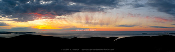 Acadia National Park. Maine. USA. View ot Atlantic Ocean & clouds at sunrise from summit of Cadillac Mountain.  Mt. Desert Island.