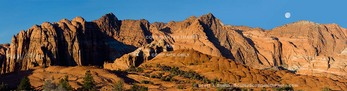 Snow Canyon State Park, Utah. USA. Setting moon over Red Mountain. Snow Canyon.