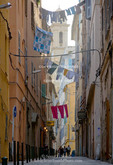 Corsica. France. Europe. Clothes drying on lines across narrow street in Bastia.