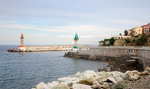 Corsica. France. Europe. Harbor entrance at Old Port in Bastia.