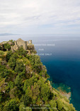 Corsica. France. Europe. Ruins of Genoese Tower above Mediterreanean Sea at village of Nonza. Cap Corse.