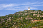 Corsica. France. Europe. Old windmill on ridge on Cap Corse.