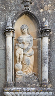 Corsica. France. Europe. Statue flanking door to mausoleum adjacent to Cathedral of Nebbio (church of Santa Maria Assunta). Near St. Florent.