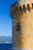 Corsica. France. Europe.  Moon & remains of Genoese tower on Point Mortella (Punta Mortella) on coast of Gulf of St. Florent (Golfe de St. Florent).