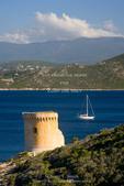 Corsica. France. Europe.  Remains of Genoese tower on Point Mortella (Punta Mortella) on coast of Gulf of St. Florent (Golfe de St. Florent).