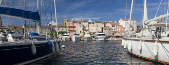 Corsica. France. Europe. Boats in marina at St. Florent.