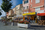 Corsica. France. Europe. Waterfront cafes & apartments in St. Florent.