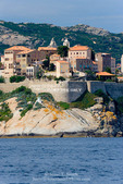 Corsica. France. Europe. Buildings of the old city at Calvi within the walls of the historic Venetian fortress.