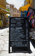 Corsica. France. Europe. Daily menu of cafe posted on the street in Calvi.
