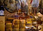 Corsica. France. Europe. Local cheeses & charcuterie (cured meats) at shop in Calvi offering products of Corsica.