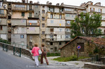 Corsica. France. Europe. Pedestrians & apartment buildings in Corte.