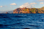 Corsica. France. Europe. Pinnacles of red granite rise out of the sea at Punta Pallazzu. Reserve Naturelle Scandola (Scandola Nature Reserve). Corsica Regional Park. UNESCO World Heritage Site.