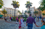 Corsica. France. Europe. Pedestrians below statue of Napoleon at Place Foch. Ajaccio.