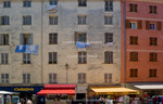 Corsica. France. Europe. Apartment buildings & stores along Cours Napoleon in Ajaccio.