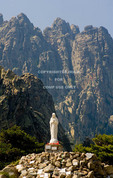 Corsica. France. Europe. Shrine to Our Lady of the Snows at Col de Bavella below pinnacles of Aiguilles de Bavella.