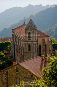 Corsica. France. Europe. Church & house in mountain village of Zicavo above gorge of Molina River (Ruisseau de Molina).