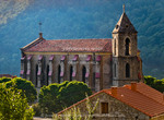 Corsica. France. Europe. Church & house in mountain village of Zicavo.