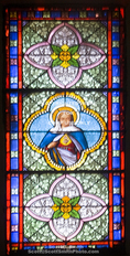 Corsica. France. Europe. Stained glass in church in Sartene.