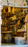 Corsica. France. Europe. View through door of charcuterie, a shop selling cured meats. Sartene.