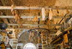 Corsica. France. Europe. Inside a charcuterie, a shop selling cured meats. Sartene.