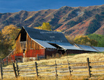UTAH. USA. Barn below the Wellsville Mountains in autumn. Cache Valley. Great Basin.