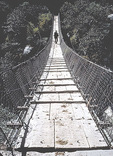 Hiking in Nepal includes crossing interesting bridges