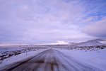 A Deserted and Windswept Highway in the Nevada Desert