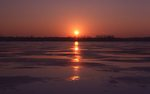 A Winter Sunset over the Icy Mississippi River