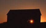 An Old Corn Crib at Sunset