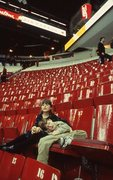 A Young Fan Sleeps after a Game at the Montreal Forum