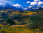 Mount Sneffels and the snow capped San Juan range above the autumn colors in East Dallas Creek valley  