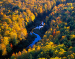 Big Carp River meanders through hardwood forest in fall color - from the escarpment overlook above the Lake of the Clouds