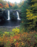 Little Manitou falls on the Black river with hardwood forest in autumn colors