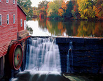 Dells Mill (1864) waterwheel with mill pond reflections of hardwoods in fall color