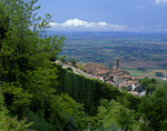 View of the hilltown, Cortona with tiled roofs and tower, above the Val di Chiana valley