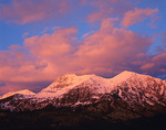 The Ruby Range peaks in the Raggeds Wilderness Area under sunset colored clouds in Gunnison National Forest, CO