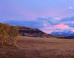 Clearing storm clouds at sunset from the foothills of the San Juan Mountains in Uncompahgre National Forest, CO