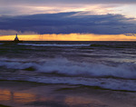 Lighthouse under turbulent dusk clouds in F. J. McClain State Park, MI