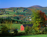 Caledonia County, VT: Farms nestled in a valley of green pastures and autumn colored hardwood forests near Peacham